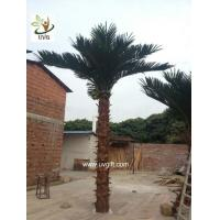 Buy cheap UVG PTR017 ornamental fake coconut tree price with real bark for theme park decoration from wholesalers