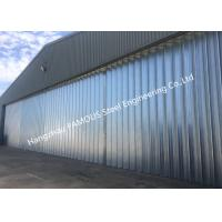 Buy cheap Stable Triangular Seal Vertical Hinged Door Sectional Leaves Folding Sliding Hangar Doors from wholesalers