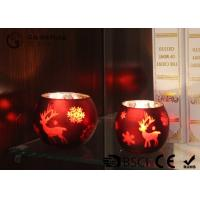 Buy cheap painted ball shape glass candle holder with laser picture with LED tealight product