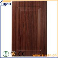 Buy cheap black wood grain pvc film pressed custom design mdf kitchen cabinet doors from wholesalers