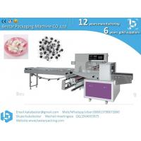 China Small food packing machine Compress face mask packing machine,Flow packing machine with automatic feeder on sale