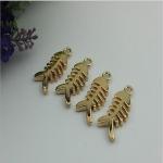 Buy cheap Small light gold fish bones pattern zinc alloy metal handbag logo label tags for sales from wholesalers