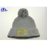 Buy cheap 100% Acrylic Knit Beanie With Pom On Top And Gold Color Logo On Front from wholesalers