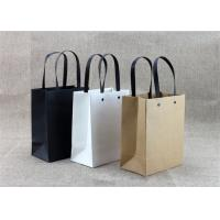 Buy cheap Partial UVcoating Eco Printed Kraft Custom Paper Shopping Bags With Ribbon from wholesalers
