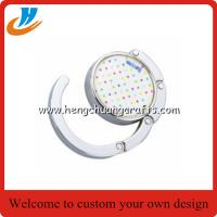 China Folding Round Bag Hanger,bag holder hook with custom print logo on sale
