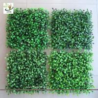 Buy cheap UVG GRS02 UV protected green plastic grass panels faux boxwood for garden wall decoration from wholesalers
