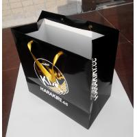 Buy cheap 2016 custom paper bag manufacturer with gold stamping logo gold satin ribbon handle from wholesalers