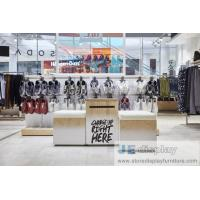 Buy cheap Leisure young people Cloth chaine brand store interior by metal display rack and MDF wood veneer panel counters from wholesalers