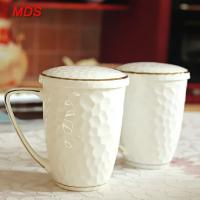 Buy cheap Creative water cube embossed bone china mug with gold rim and lid from wholesalers