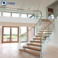 Buy cheap fancy wood tread curved staircase design with glass balustrade from wholesalers