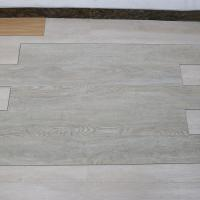 Buy cheap non deformation wood grain uv coating embossed PVC vinyl flooring planks product