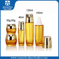 Buy cheap Color-Coating Yellow Cosmetic Glass Bottles ,  Empty Lotion Bottles  With Plastic Pump Cap from wholesalers
