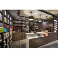 Buy cheap Chinese Tea shop fits out Dark Walnut solid wood in-Wall cabinets with Shelves and reception counters from wholesalers