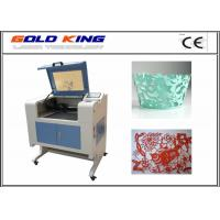Buy cheap cheap 40w laser cutting and engraving machine 6040 with motorized up and down working table and rotary axis from wholesalers
