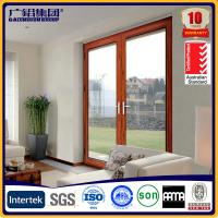 Buy cheap wooden color aluminium glass double sashes swing doors from wholesalers