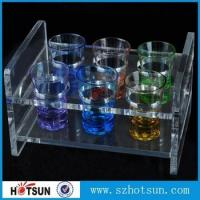 Buy cheap China factory wholesale black or clear colored acrylic shot glass serving holder tray from wholesalers