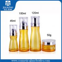 Buy cheap Fancy Skin Care Cosmetic Glass Bottles 120ml Yellow Empty Packaging With Pump from wholesalers
