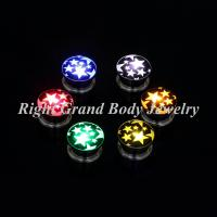 Buy cheap Steel LED Shinning Light Ear Flesh Tunnels Plugs With Star Logo Epoxy from wholesalers