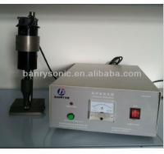 Buy cheap ultrasonic spunlace nonwoven rolls cutting machine ultrasonic fabric cutter from wholesalers