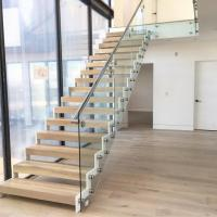 Buy cheap Modern design steel structure staircase with side mounted glass balustrade product