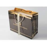 Buy cheap Luxury Glossy Black Gift Bags With Foil Hot Stamping And PP Rope Handle from wholesalers