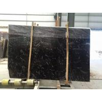 Buy cheap China white veined black marble slab from wholesalers