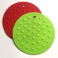 Buy cheap round silicone hot mat from wholesalers
