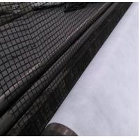 Geogrid composite geotextile