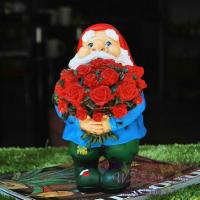 Buy cheap resin garden decoration santa figurine with red rose from wholesalers