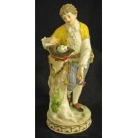 Porcelain - China Meissen figurine of gentleman collecting eggs in his hat. Height 7 3/4 in.
